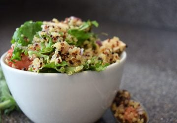 A finished bowl of Mediterranean Kale and Quinoa