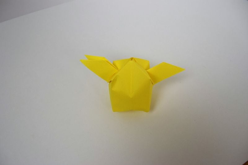 yellow paper snitch with white background