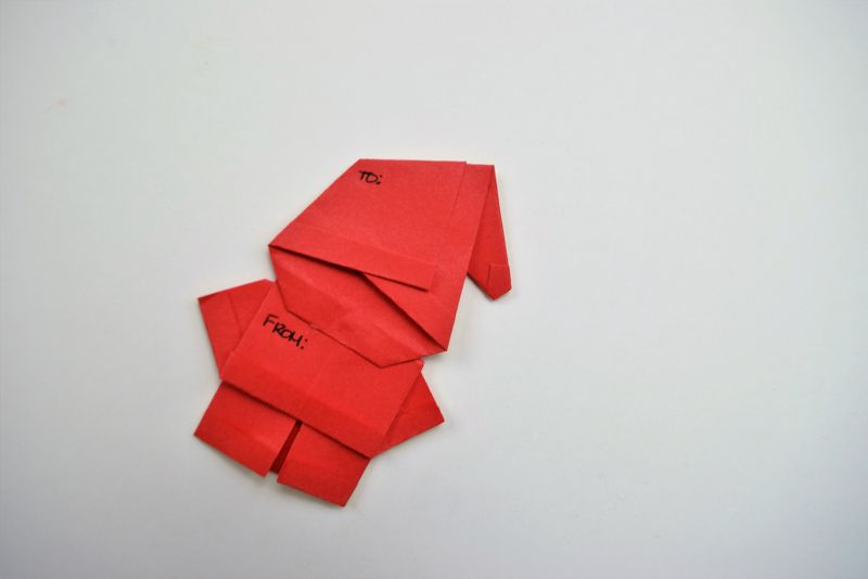 red origami santa on white bacground